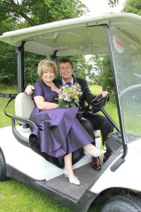 Mark and Tricia smiling on their wedding day...